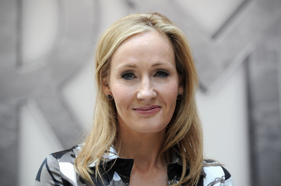 "(FILES) In a file picture taken on June 23, 2011 Harry Potter creator J.K. Rowling poses for photographers during the launch of her new project 'www.pottermore.com' in central London. Rowling said on June 11, 2014 she had donated 1 million GBP (1.2 million euros, 1.7 million USD) to the ""No"" campaign in the Scottish independence referendum.  AFP PHOTO / CARL COURT / AFP / CARL COURT"
